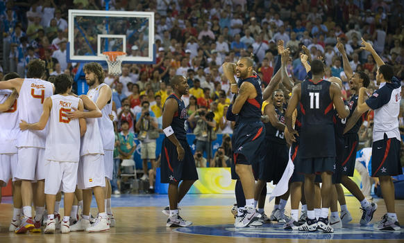 Members of the United States team, at right, celebrate defeating Spain in the 2008 gold medal game.