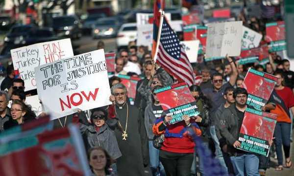 Thousands of Armenian-Americans protest outside the Turkish Consulate on the anniversary of the Armenian Genocide.
