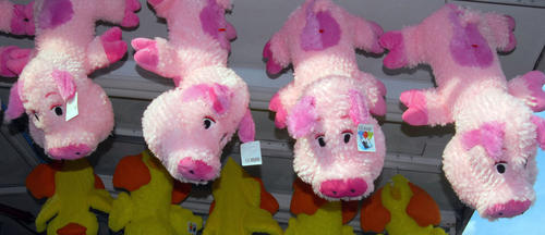 Stuffed pigs hang from the top of the Big Farm House game stand on Thursday at the Northampton Community Days Fair being held at the Northampton Municipal Park at Laubach Avenue and Smith Lane. The Fair, which began on Wednesday, ends with a full-scale fireworks show on Saturday. Hours are 6-10 p.m. on Friday and 6-11 p.m. Saturday. The fair, which features games, rides, food and musical entertainment, benefits the Exchange Club of Northampton.