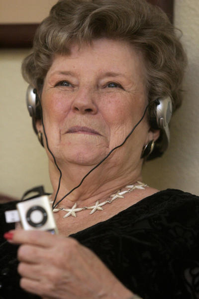 "Resident Marsha Snyder smiles as she listens to music on an <a class=""taxInlineTagLink"" id=""PRDCES000000025"" title=""Apple iPod"" href=""/topic/services-shopping/electronic-devices/apple-ipod-PRDCES000000025.topic"">iPod Nano</a> at Villa Ventura retirement community in Kansas City, <a class=""taxInlineTagLink"" id=""PLGEO100103100000000"" title=""Missouri"" href=""/topic/us/missouri-PLGEO100103100000000.topic"">Missouri</a>.<br> <br> If you're feeling down, the best way to change your tune might be to listen to or even play one. A 2006 Journal of Advanced Nursing  study found that listening to music for an hour a day for a week could reduce symptoms of depression by up to 25 percent."