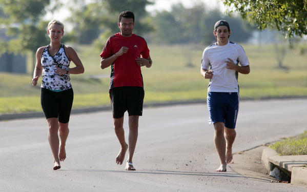 "Runners run barefoot around some debris from Coldstream Park in Lexington, <a class=""taxInlineTagLink"" id=""PLGEO100102400000000"" title=""Kentucky"" href=""/topic/us/kentucky-PLGEO100102400000000.topic"">Kentucky</a>.<br> <br> Compared with sedentary subjects, those who ran regularly were 70 percent less likely to experience high stress and life dissatisfaction, according to a study of more than 12,000 people published in the Scandinavian Journal of Medicine & Science in Sports. Regular exercise increases adrenal activity, which facilitates stress adaptation and enhances the release of <a class=""taxInlineTagLink"" id=""HHA000030"" title=""Hormones and Metabolism"" href=""/topic/health/human-body/hormones-metabolism-HHA000030.topic"">hormones</a> like noradrenaline, serotonin, beta-endorphin, and dopamine. These hormones all improve mood, says Peter Schnohr, M.D., the study's lead author."