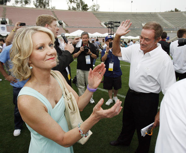 Andrea Kremer, of NBC and HBO Sports, claps after she introduces Al Michaels at the Rose Bowl in Pasadena for the NFL All-Access Event.