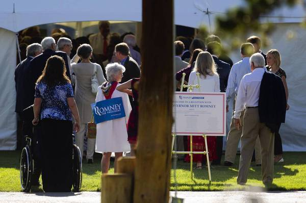 People line up for a Mitt Romney fundraiser in Wilson, Wyo., hosted by former Vice President Dick Cheney.