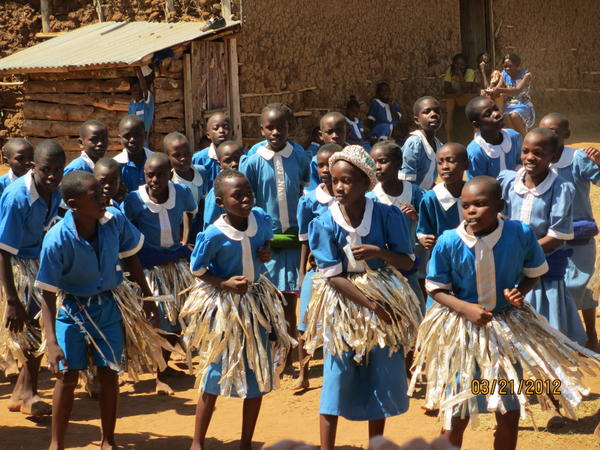 Children dance at Kisima Academy in western Kenya, welcoming U.S. visitors to their school.