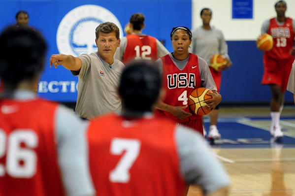 Head Coach Geno Auriemma directs players in drills with Cappie Pondexter by his side during the first practice for the USA Women's National Team at Connecticut College in New London in 2010.