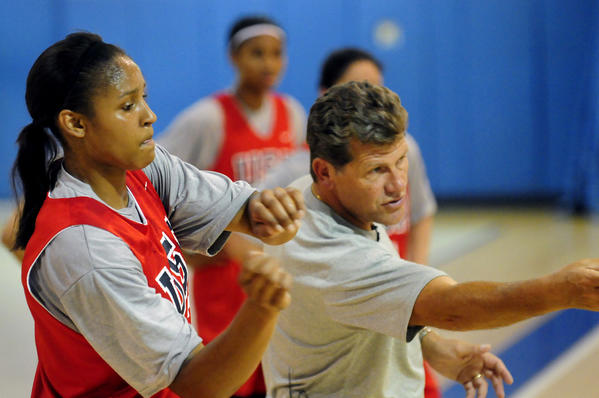 - Maya Moore mimics a drill with Head Coach Geno Auriemma during the first practice for the USA Women's National Team at Connecticut College in New London in July 2010.