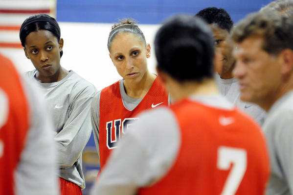 From left, Swin Cash and Diana Taurasi listen to Head Coach Geno Auriemma during the first practice for the USA Women's National Team at Connecticut College in New London in July 2010.