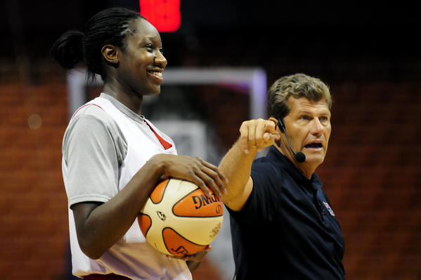 Tina Charles jokes around as Head Coach Geno Auriemma directs the team during open practice for the USA Women's National Team at the Mohegan Sun Arena in July 2010.