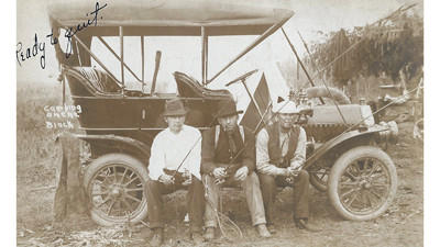 "This photo is from a camping trip the author's grandfather was on. The three men are sitting on the running board of their car with fishing poles in hand. On the card it is handwritten ""Ready to quit,"" and printed is ""camping on the Black (River). The men are (from left) Russ Leavenworth, Clint Herron and Frank McWain, the author's grandfather. Courtesy photo"