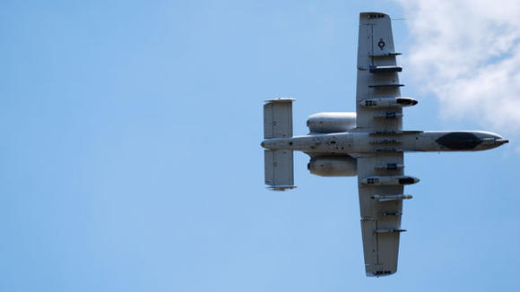 An A-10 Thunderbolt makes a low pass over wilderness area near Range 40.