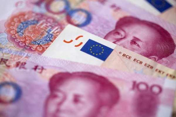 Chinese renminbi and European Union euro banknotes. China's slowing economic growth could have implications for Europe and the U.S., both major trading partners.