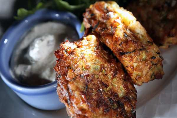 Zucchini and manouri fritters