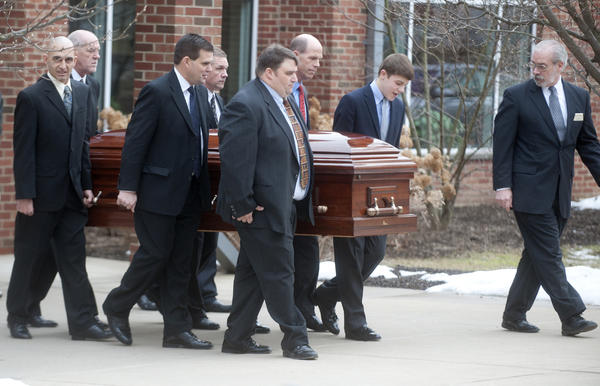 Pallbearers load the casket into the hearse as services are held for Penn State's legendary football coach and humanitarian Joseph Vincent Paterno at the Pasquerilla Spiritual Center on the campus on Wednesday.