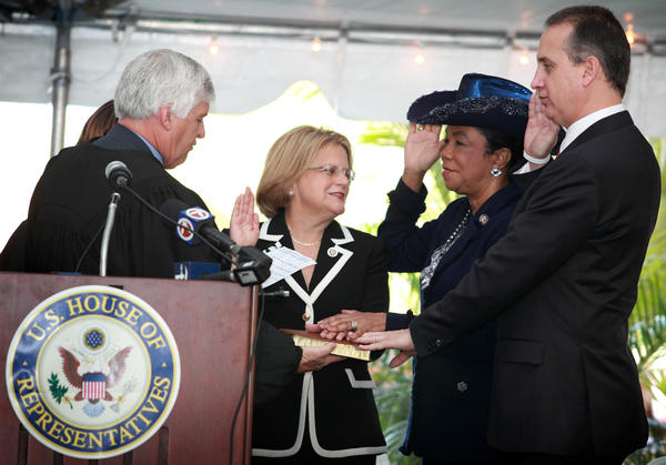 Congress Members Ileana Ros Lehtinen, center, Federica Wilson and Mario Diaz Balart, attend the South Florida Congressional Delegation Local Swearing-in ceremony at the Federal Courthouse in Miami on Monday January 10, 2011.