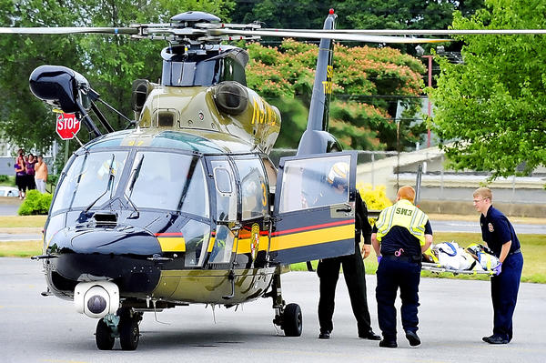 A six-year-old girl is put into Trooper 3 after being struck by a car while riding a bicycle on Mechanic St. in Hagerstown Friday afternoon. The child was flown to Children's Hospital. The helicopter landed in the former County Market parking lot.