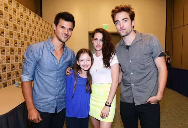 Actors Taylor Lautner, Mackenzie Foy, Kristen Stewart and Robert Pattinson attend 'The Twilight Saga: Breaking Dawn Part 2' during Comic-Con International 2012.