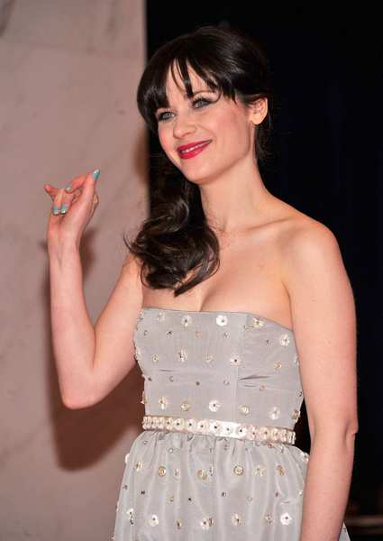 Zooey Deschanel sported turquoise striped nails when she attended the 98th Annual White House Correspondents' Assn. Dinner.