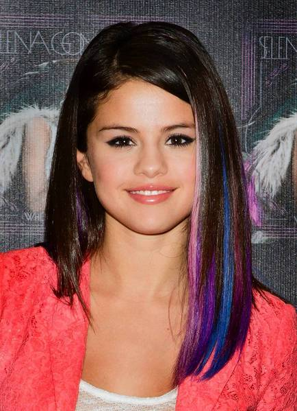 Singer Selena Gomez sports jewel-toned streaks in her smooth 'do.
