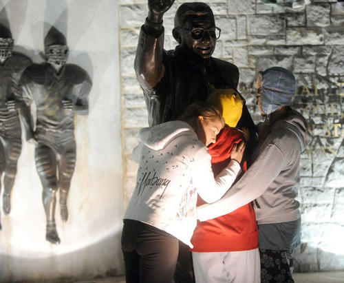 The Penn State University students, many in tears, gather around the statue of Coach Joe Paterno after the news of his firing in University Park on Wednesday November 9, 2011.