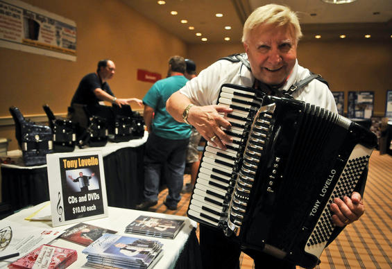 Tony Lovello, a renowned accordion player from Buffalo, N.Y., plays the accordion at his stand at the 2012 American Accordionists' Association Festival
