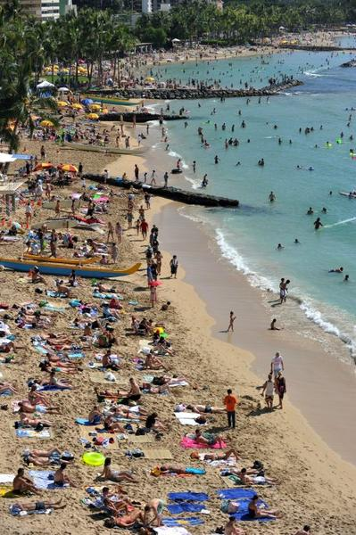 "Tourists enjoy sunbathing, surfing, boating and swimming at Waikiki beach in <a class=""taxInlineTagLink"" id=""PLGEO100101101011263"" title=""Honolulu"" href=""/topic/us/hawaii/honolulu-county/honolulu-PLGEO100101101011263.topic"">Honolulu</a>, Hawaii. Waikiki, which is a popular tourist destination, was a retreat for Hawaiian royalty in the 1800s. Much like the locals and tourists of today, Hawaiian royalty enjoyed surfing at Waikiki on early forms of longboards."
