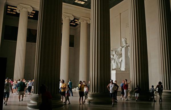 Tourists visit the Lincoln Memorial in Washington DC. Each year thousands of tourists visit the monuments and many attractions at the nations capitol.