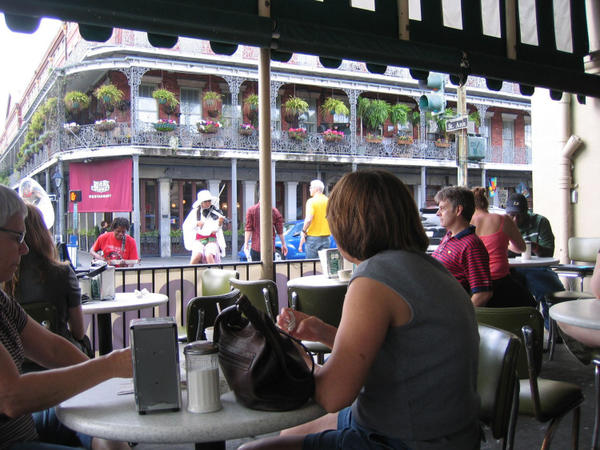 Tourists have returned in strength to a city devastated by Katrina. Evidence can be seen at the landmark New Orleans' Café du Monde, the most famous coffeehouse in America, and arguably the world. Here we see patrons enjoying live music.