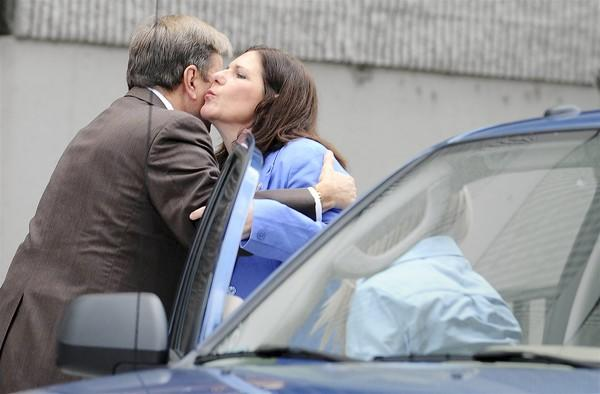 Suspended School Board member Beverly Gallagher kisses her attorney Dave Bogenschutz after leaving the federal courthouse on Friday.