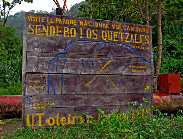 A sign marks the entrance to the Quetzal trail in Boquete, Panama. The trail meanders through the cloud forest, past streams and a wide variety of flora and fauna, including quetzals.