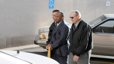Calvin Mallory Jr. escorted to the last day of his trial for murder in April.