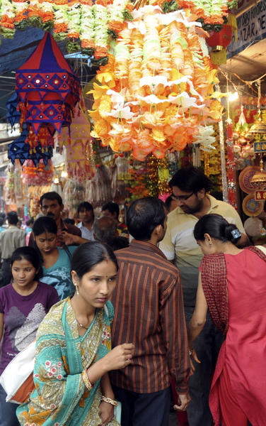Prospective Indian customers shop for gifts and decorative items ahead of the forthcoming Hindu festival of Diwali, The Festival of Lights at a busy market place in New Delhi.