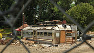 They peeled the facade off the old Forest Diner on U.S. 40 in Ellicott City, revealing an American classic. Stainless steel, glass, and compact as a caboose, the restaurant's original core from about 1950 sits<strong> </strong>in a vacant dirt-and-gravel lot behind a chain-link fence.
