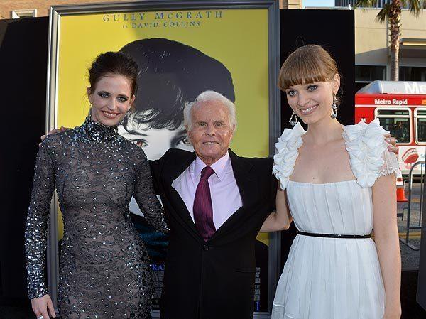 "Actress Eva Green, producer Richard D. Zanuck and actress Bella Heathcote arrive at the premiere of Warner Bros. Pictures' ""Dark Shadows"" at Grauman's Chinese Theatre on May 7, 2012, in Hollywood."