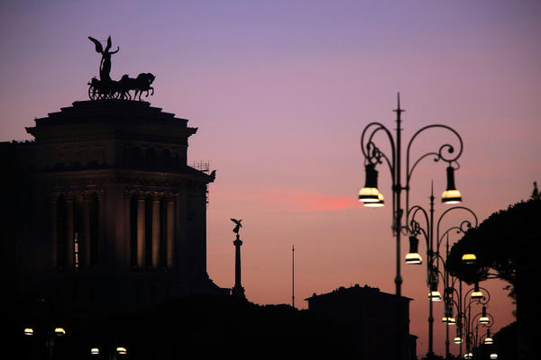 "A view of the Vittorio Emmanuele II monument at sunset on July 9, 2009 in <a class=""taxInlineTagLink"" id=""PLGEO100100602011404"" title=""Rome (Italy)"" href=""/topic/intl/italy/rome-%28italy%29-PLGEO100100602011404.topic"">Rome</a>, Italy. With nearly 3000 years of history Rome continues to live up to its motto of The Eternal City being one of the founding cities of Western Civilisation."