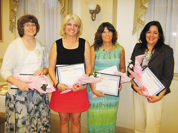 Church Women United members are, from left, Tammy Staley, Lori Beth Ridenour, Amy Macomber and Amanda Boyer-Everett.