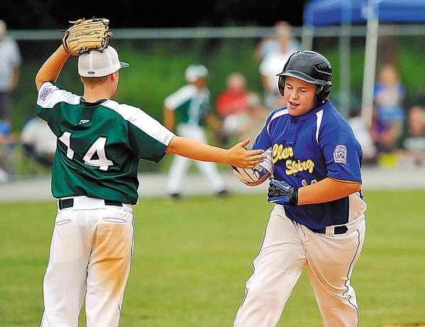 National shortstop Brock Penn, left, congratulates Clear Spring's A.J. Yost as he rounds the bases after hitting a three-run homer in the fourth inning Friday.