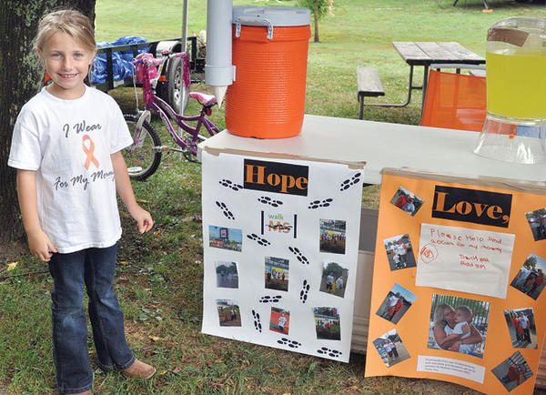 Addison Rogers, 5, of Winchester, sells lemonade,water and other drinks at Fort Boonesborough State Park Friday afternoon to raise money for multiple sclerosis research. Addison¿s mother, Chenelle Rogers, was diagnosed with MS¿in 2009. Addison has operated the beverage stand for a few days at the park and will have it again today.