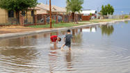 Children play on a flooded street