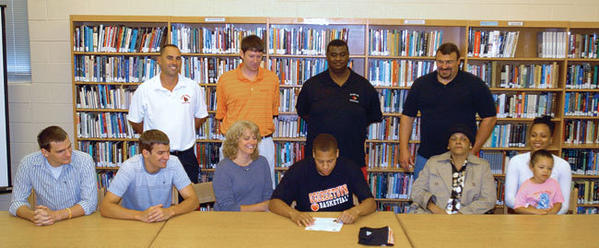 Recent George Rogers Clark graduate Charlie Rogers signed a national letter-of-intent with Georgetown College Friday morning at the school. Rogers was joined on the front row from left to right by Eric Fatkin, Adam Fatkin, Debbie Fatkin, mother Maxine Graham, sister Prisha Rogers and niece Aaliyah Graham . Back row from left: Clark coach Scott Humphrey, Georgetown College coach Chris Briggs, uncle and Clark girls basketball coach Robbie Graham and Mark Fatkin.