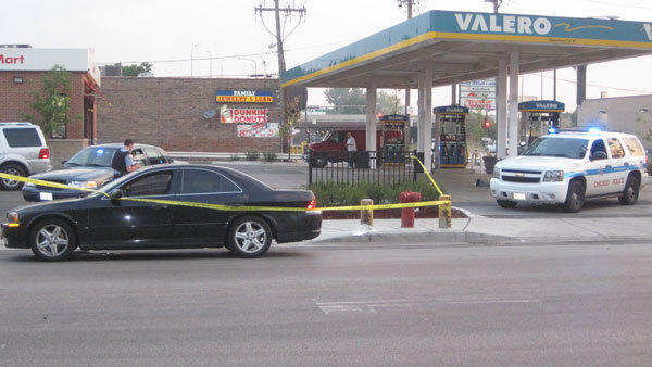 A 25-year-old man was shot here about 5 a.m. on July 14, 2012. The black sedan pictured was rammed by an SUV before getting shot at a few minutes later, according to witnesses.