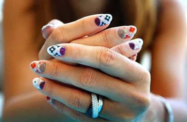 Owner Hiroko Fujikawa shows off her nail design inspired by the Prada Fall/Winter collection 2012, at MARS The Salon in West Hollywood on Tuesday, July 3, 2012.