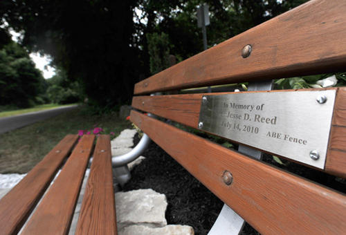 A close up of the memorial bench that is dedicated in honor of Spc. Jesse D. Reed, who was killed in Afghanistan in 2010, on Saturday morning. The memorial bench is located along the Ironton Rail to Trails trail near the American Legion Post 739 in Hokendauquqa.
