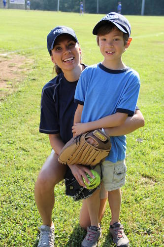 Fox CT Anchor Erika Arias poses with her seven year-old son Laitham before the start of the game.