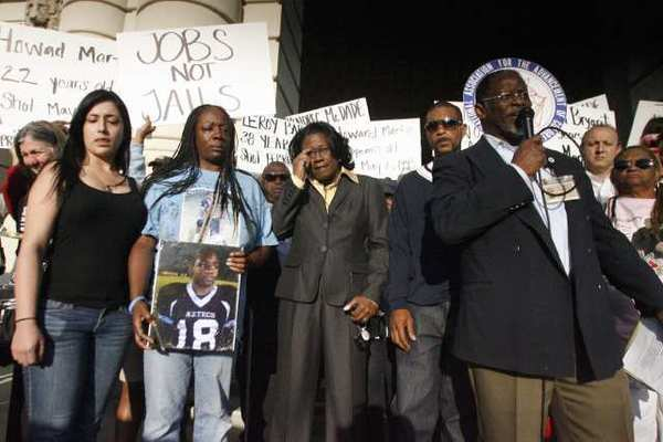 Attorney Caree Harper, center, and family members of Kendrec McDade attend a rally in front of Pasadena City Hall. NAACP organized the rally in response to the Kendrec McDade shooting.