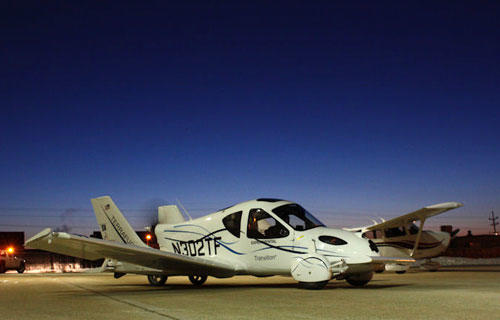 "<i>By Los Angeles Times Staff Writers</i><br> <br> Several years in the making, the Terrafugia Transition made a successful first test flight this week at Plattsburgh International Airport in upstate New York.<br> <br> Often referred to as a ""flying car,"" the Transition (created by Terrafugia Inc.) is a two-seat aircraft designed to take off and land at local airports and drive on any road.<br> <br> You Tube video>> <a href=""http://www.youtube.com/watch?v=EHXnLCIgNug"">First Flight: ""Flying Car"" Terrafugia Transition Roadable Aircraft</a>"