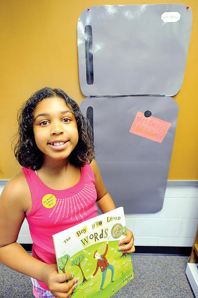 Bester Elementary School incoming 5th grader Amia Applewhite with principal Bachtell's Fab Fridge.