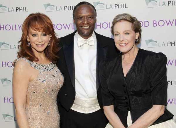 Reba McEntire, left, and Julie Andrews flank Thomas Wilkins, guest Hollywood Bowl conductor, for the annual opening night gala at the Hollywood Bowl. McEntire was inducted into the Hollywood Bowl Hall of Fame at the concert.