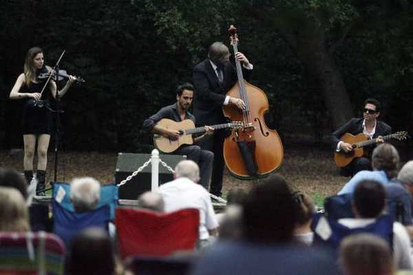 The Gonzalo Bergara Quartet violinist Leah Zeger, from left, lead guitarist Gonzalo Bergara, bass player Brian Netzley and rhythm guitarist Jeffrey Radaich perform at Descanso Gardens in La Canada.