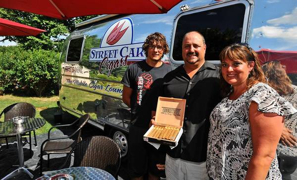 Ron and Wendy Riedi and their son Cody Chidsey show off their customized 1973 Airstream trailer, Street Car Cigars. The mobile cigar lounge, now available in the Lehigh Valley, contains a humidor, lounge, 5 HDTV flat screens, and all things cigars.
