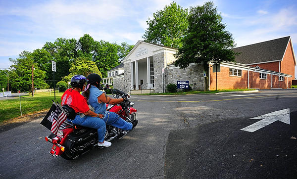 Barbara and Bill Dutton of Hagerstown arrive Saturday for an outdoor worship service at St. Mark's Episcopal Church in Lappans.